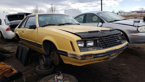 1982 ford mustang in colorado junkyard