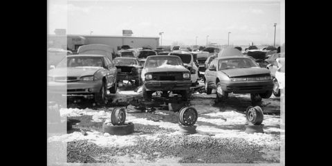 1985 chevrolet chevette in denver junkyard, photographed with canon 110ed film camera