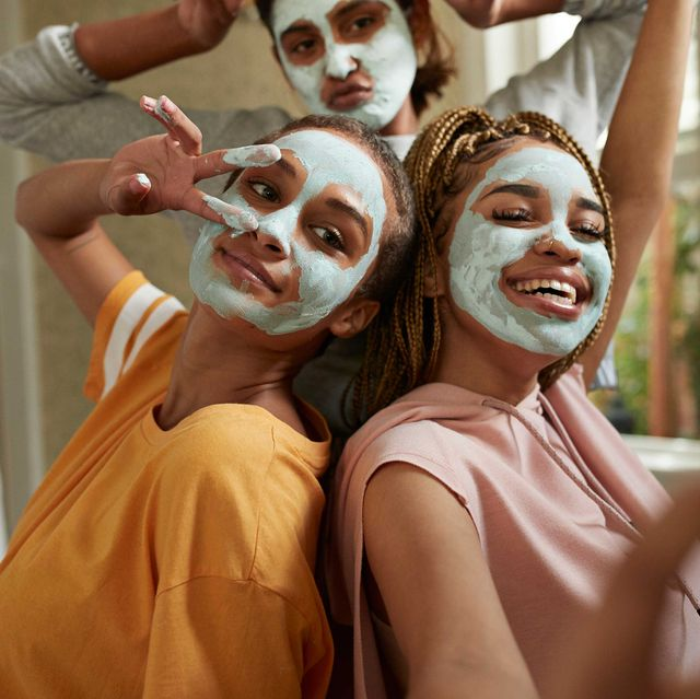 friends posing with face masks