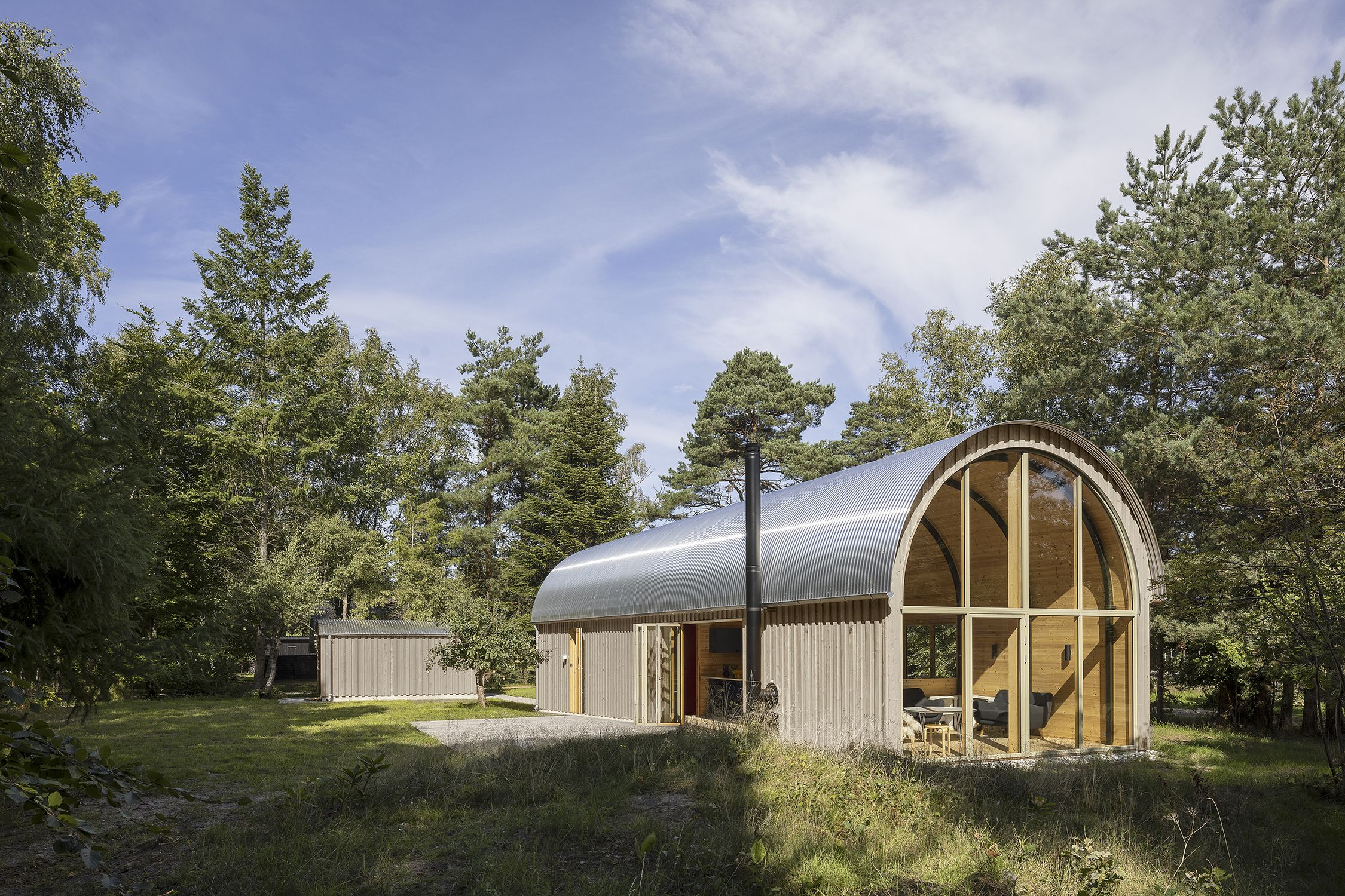 A Barrel-Vaulted Barn Surrounded by the Scent of Pine