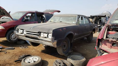 1967 oldsmobile cutlass town sedan in denver junkyard