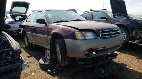 2000 subaru legacy outback sedan in colorado junkyard