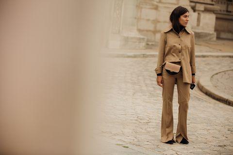 Fashion model, Clothing, Fashion, Beauty, Skin, Leg, Standing, Beige, Human, Human leg,