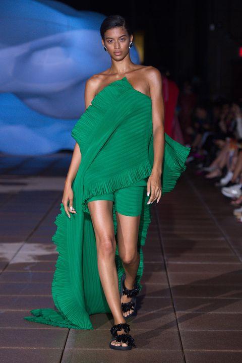 Fashion model, Fashion show, Fashion, Runway, Shoulder, Clothing, Fashion design, Model, Dress, Event,