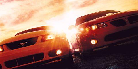2004 Ford SVT Mustang Cobra vs  2004 Pontiac GTO