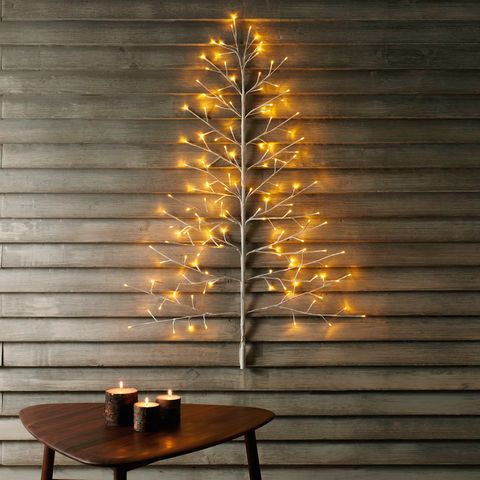 Lighting, Tree, Branch, Light, Christmas decoration, Christmas tree, Wall, Leaf, Wood, Light fixture,