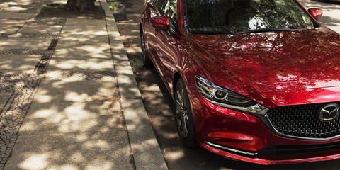 Land vehicle, Vehicle, Car, Automotive design, Mazda, Red, Luxury vehicle, Mid-size car, Performance car, Grille,