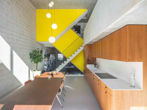 Architecture, Ceiling, Yellow, Interior design, Orange, Room, Building, Wall, Stairs, Daylighting,