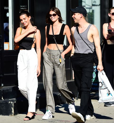 Clothing, Street fashion, Fashion, Fashion model, Eyewear, Sportswear, Sunglasses, Leg, Trousers, Waist,