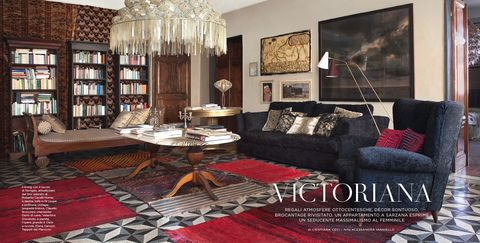 Living room, Room, Furniture, Interior design, Property, Red, Coffee table, Couch, Table, Building,