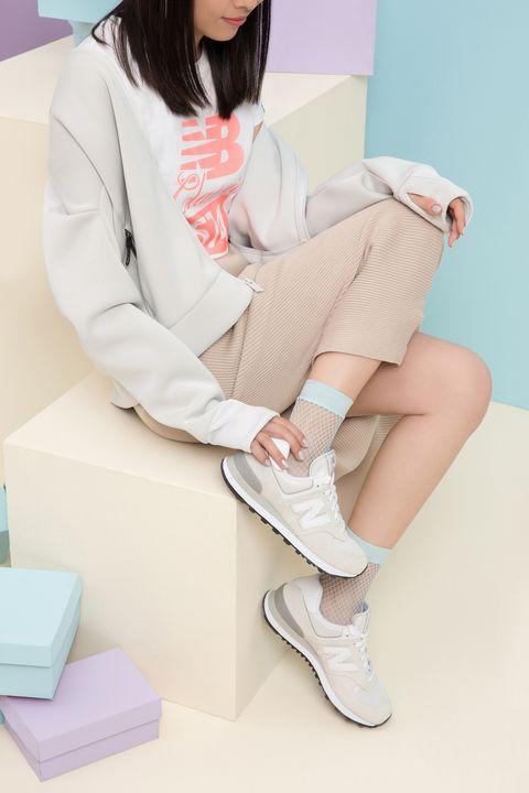 White, Leg, Pink, Clothing, Footwear, Skin, Sitting, Beauty, Thigh, Human leg,