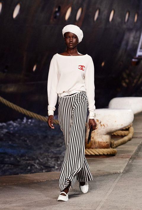 White, Street fashion, Clothing, Fashion, Black-and-white, Sportswear, Fashion model, Trousers, Neck, Waist,
