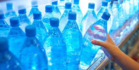 Bottled water on shelf in supermarket