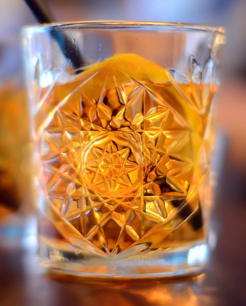 Old fashioned glass, Drink, Yellow, Amber, Drinkware, Glass, Orange, Distilled beverage, Liqueur, Whisky,