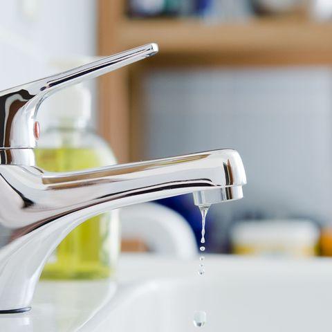 Tap, Plumbing fixture, Eyewear, Sink, Room, Material property, Plumbing, Glasses, Metal,