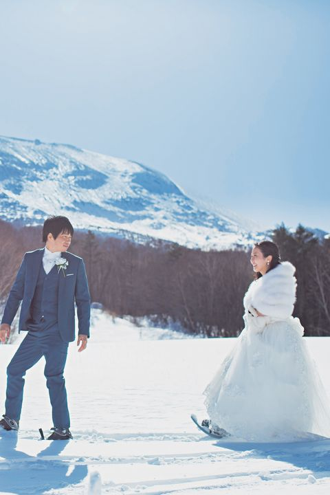 Photograph, Blue, Snow, Sky, Bride, Winter, Yellow, Wedding dress, Dress, Ceremony,