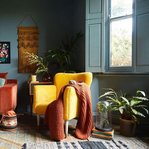 Room, Furniture, Living room, Orange, Interior design, Yellow, Table, Lighting, Lamp, Floor,