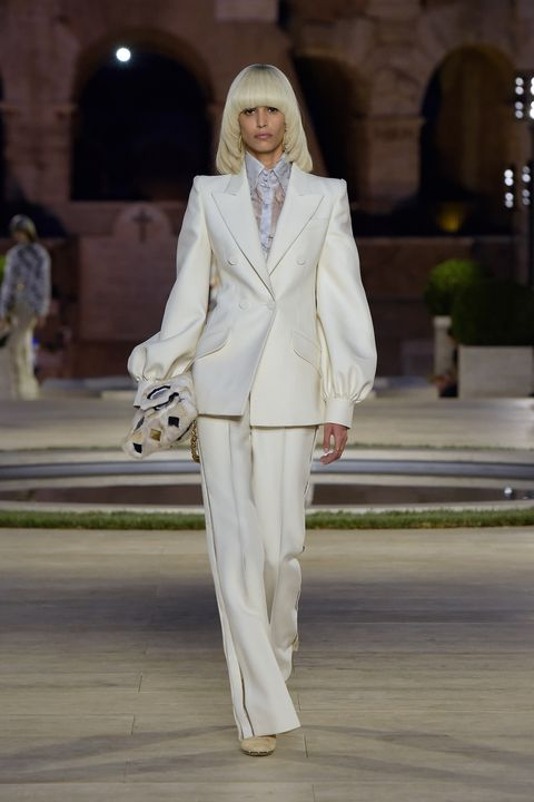 Fashion model, Fashion, White, Clothing, Suit, Pantsuit, Haute couture, Runway, Formal wear, Fashion show,