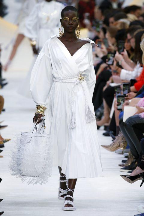Fashion, White, Fashion model, Runway, Fashion show, Shoulder, Haute couture, Fashion design, Dress, Joint,