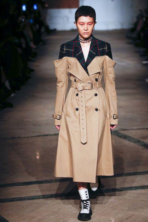 Fashion model, Fashion, Clothing, Fashion show, Runway, Coat, Trench coat, Outerwear, Overcoat, Human,