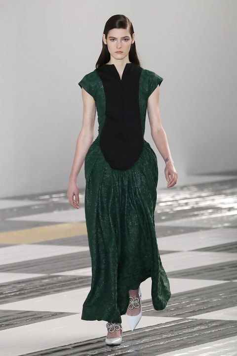 Fashion model, Fashion, Runway, Fashion show, Clothing, Green, Haute couture, Neck, Fashion design, Dress,