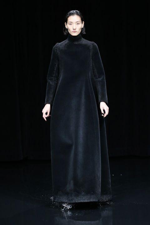 Clothing, Fashion, Outerwear, Fashion model, Overcoat, Dress, Formal wear, Coat, Fashion show, Fashion design,
