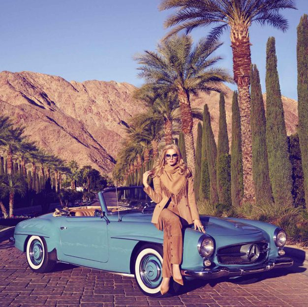 model sitting on a convertible in palm springs