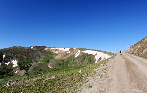 runner heading up a steep mountain