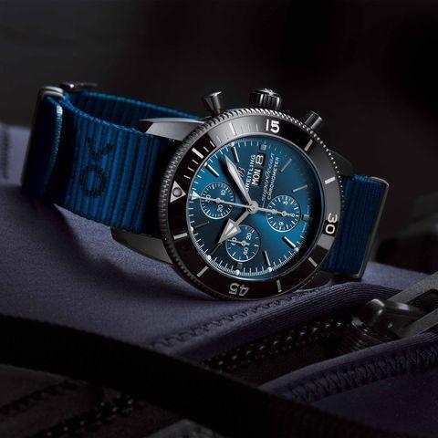 Watch, Analog watch, Watch accessory, Strap, Blue, Fashion accessory, Jewellery, Material property, Brand, Hardware accessory,