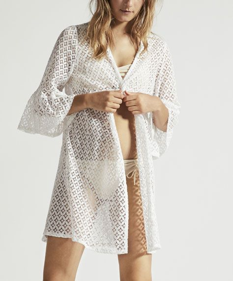 Clothing, White, Robe, Outerwear, Photo shoot, Nightwear, Dress, Cover-up, Cardigan, Fashion model,
