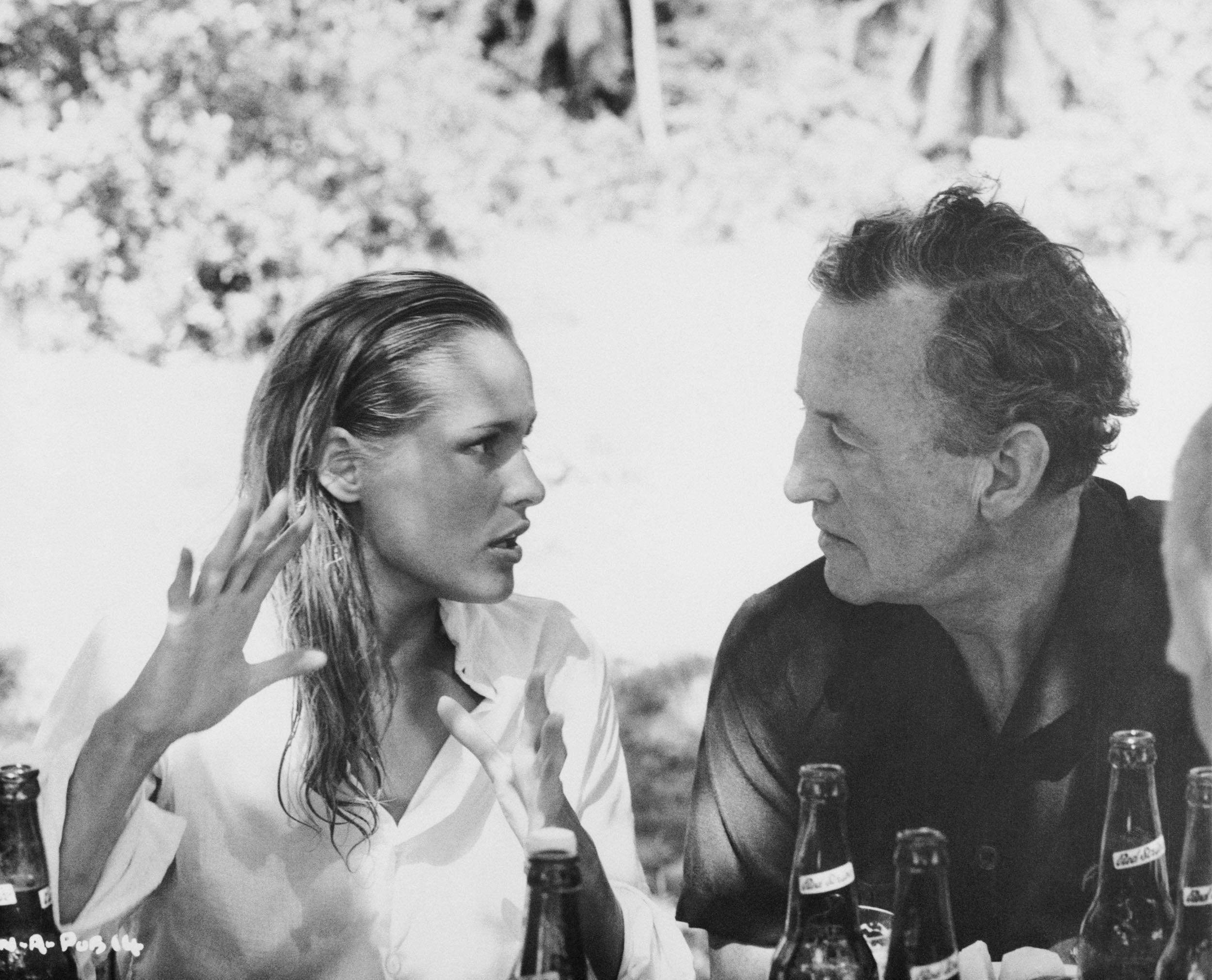 James Bond creator Ian Fleming chats with actress Ursula Andress between scenes of Dr. No.