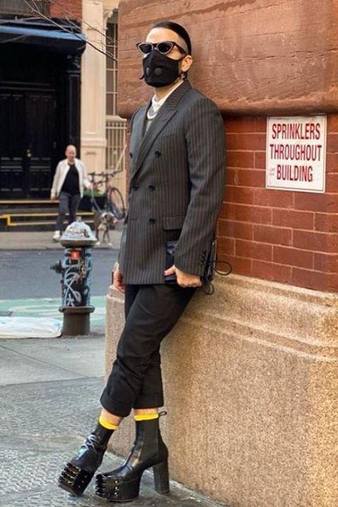 Street fashion, Clothing, Suit, Outerwear, Fashion, Snapshot, Footwear, Standing, Blazer, Human,