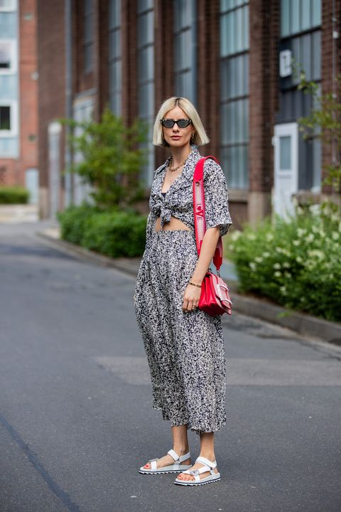 dusseldorf, germany   june 09 lisa hahnbueck is seen wearing les coyotes de paris dress with print, roger vivier red bag and white trekking sandals, gucci sunglasses on june 09, 2020 in dusseldorf, germany photo by christian vieriggetty images