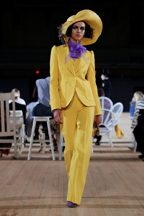 Fashion, Yellow, Fashion show, Runway, Fashion model, Haute couture, Pantsuit, Fashion design, Event, Outerwear,