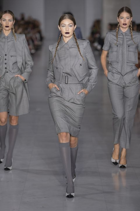Clothing, Footwear, Leg, Sleeve, Human body, Fashion show, Shoulder, Human leg, Textile, Joint,
