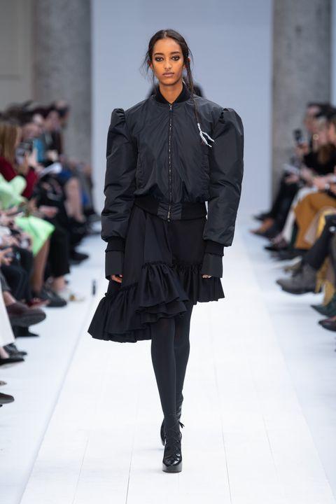 Fashion model, Fashion show, Runway, Fashion, Clothing, Fashion design, Outerwear, Human, Event, Footwear,