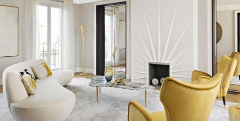 Living room, Room, Interior design, Furniture, Property, Yellow, Suite, Floor, Building, Curtain,