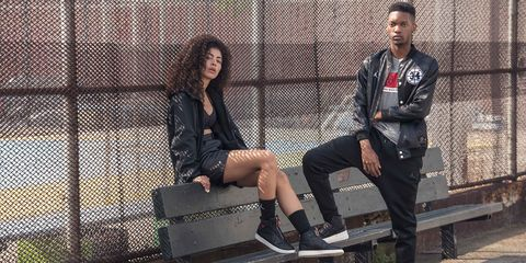 Street fashion, Fashion, Footwear, Leather, Sitting, Jacket, Leg, Textile, Photography, Shoe,