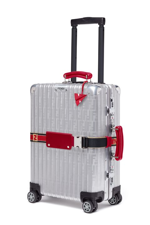 Suitcase, Hand luggage, Bag, Product, Wheel, Rolling, Luggage and bags, Baggage, Automotive wheel system, Auto part,