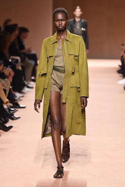 Fashion model, Fashion show, Runway, Fashion, Clothing, Coat, Fashion design, Outerwear, Human, Overcoat,