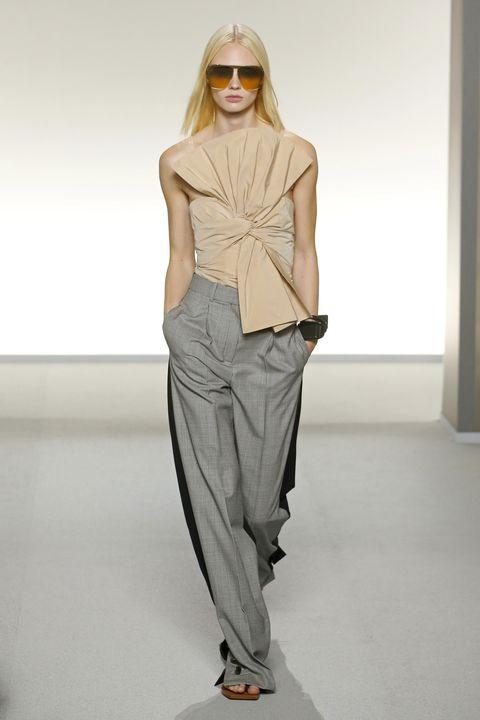Fashion model, Fashion show, Fashion, Clothing, Runway, Shoulder, Eyewear, Waist, Neck, Fashion design,