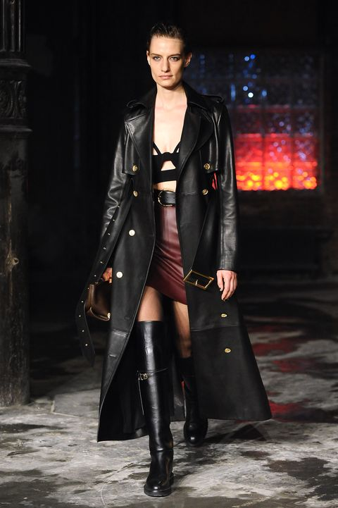 Fashion model, Fashion, Fashion show, Clothing, Runway, Coat, Outerwear, Overcoat, Haute couture, Footwear,