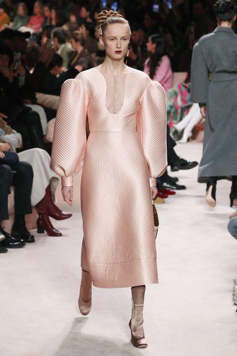 Fashion model, Fashion, Fashion show, Runway, Clothing, Haute couture, Dress, Shoulder, Lip, Event,