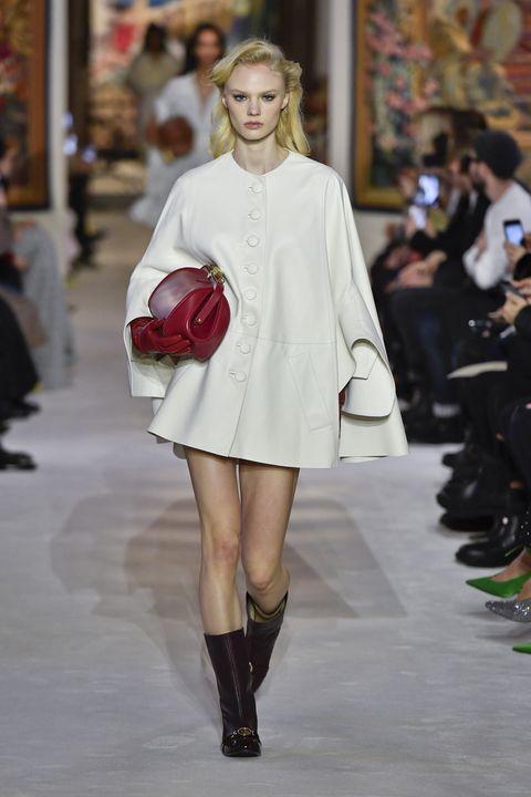 Fashion model, Fashion, Fashion show, Clothing, White, Runway, Shoulder, Joint, Footwear, Knee,