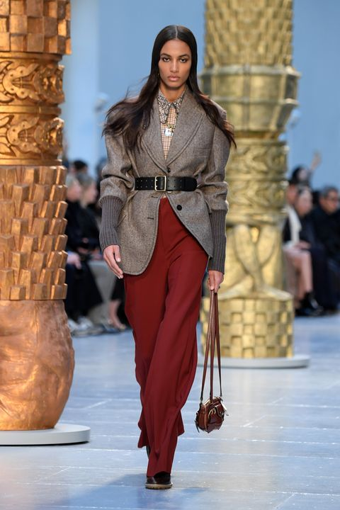 Fashion model, Fashion, Fashion show, Runway, Clothing, Haute couture, Brown, Outerwear, Event, Suit,