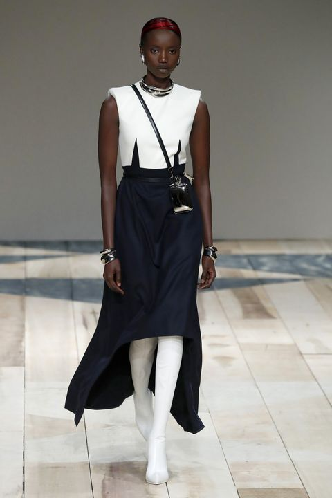 Fashion model, Fashion, White, Clothing, Fashion show, Runway, Fashion design, Dress, Shoulder, Street fashion,
