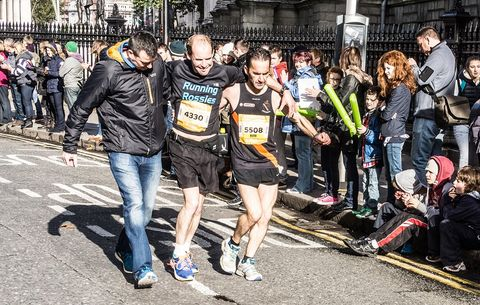 Runners helping each other