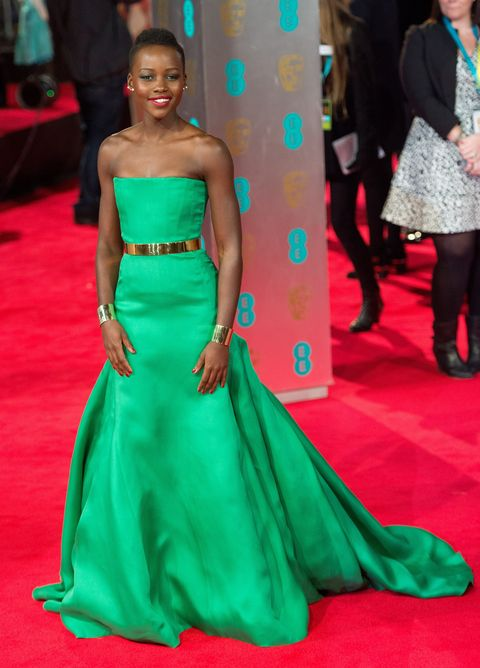 Gown, Dress, Fashion model, Clothing, Red carpet, Carpet, Green, Shoulder, Flooring, Haute couture,