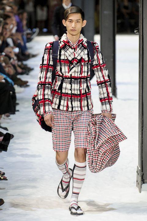 Fashion, Fashion show, Plaid, Fashion model, Runway, Tartan, Street fashion, Clothing, Pattern, Design,