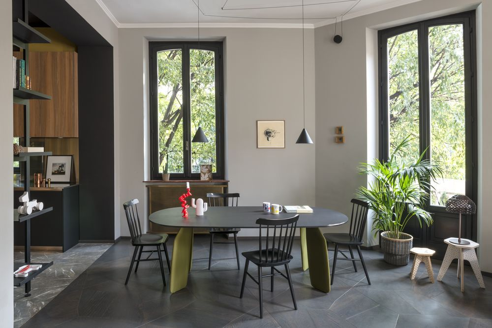 This Milanese apartment encases playful elements and monochrome scheme beautifully